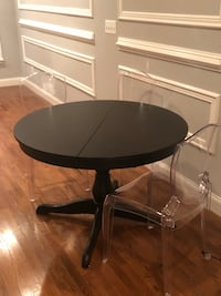 IKEA ingatorp table with clear boutique chairsRound black wooden pedestal table Baltimore, 21224