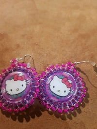 two pink and white Hello Kitty analog wall clocks Edmonton, T5G 1H3