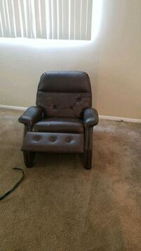black leather padded rolling armchair Tampa, 33624