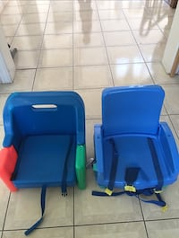 Two blue and red plastic chairs