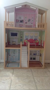 Brown green and pink doll house, dolls and more