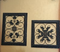 two black scrolled metal decors