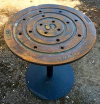 One of a kind! Rustic repurposed manhole cover pub table