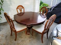 Oak table and chairs.  Minneapolis, 55427