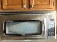 Gray and black Amana  microwave oven Highland, 92346