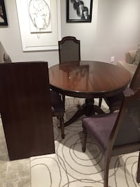 round brown wooden table with four chairs dining set Windsor, N8N 3J4