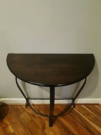 console table. wood and cast iron