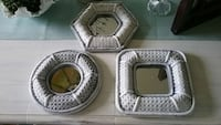 three wicker white frame mirrors