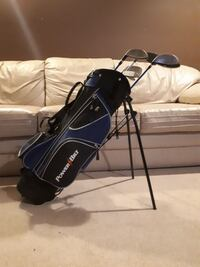 several gray golf irons with black and blue Power Bilt golf bag Prince George, V2M 6P4
