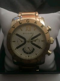 round white chronograph watch with gold link bracelet Broward County