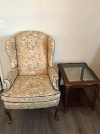 Well cared for wing back chair and side table. St. Pete Beach, 33706