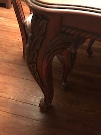 brown wooden framed brown wooden chair