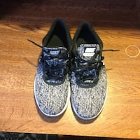 size 10White-and-black nike running shoes