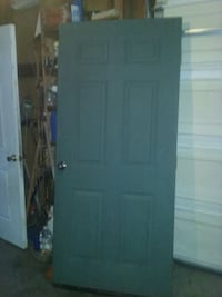 Green metal solid door