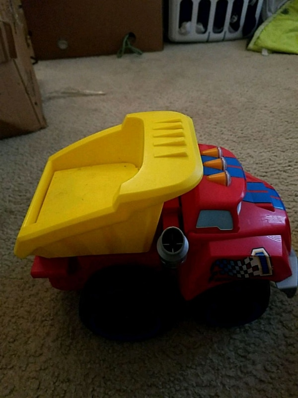 red and yellow plastic toy car