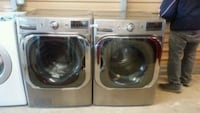 two stain front-load clothes washer and dryer set Del Valle