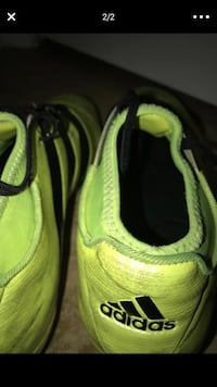 pair of green-and-black Nike basketball shoes Spring Valley