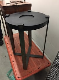black steel table stand top made of concrete