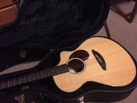 cutaway brown acoustic guitar with black case