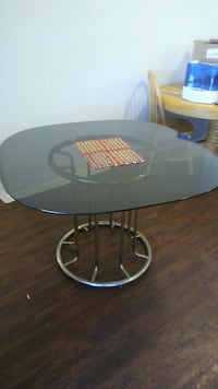 round black metal base glass top table