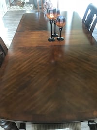 Dining room table still new condition. Plastic still on seat cushions. Chapin, 29036