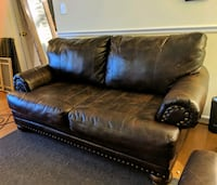 Two tone brown leather loveseat 23 km