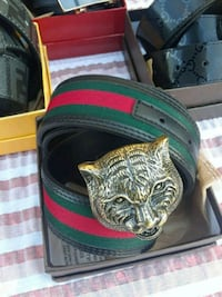 gold-colored tiger buckle Gucci leather belt with box