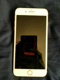 white android smartphone with case