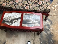 Brown wooden framed marble top coffee table New Orleans, 70130
