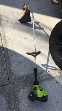 green and black gas string trimmer
