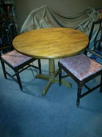 round brown wooden table with four chairs dining s Amarillo