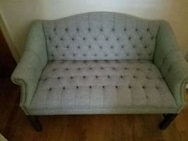 Antique Grayish brown loveseat....sturdy for a reupholstering person.