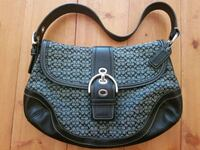 gray and black Coach monogram hobo bag