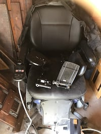 black and gray electric wheelchair 1197 mi