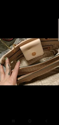 Name brand hand bag with matching wallet