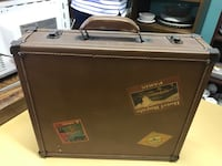 Small suit case 12x14x4 very good condition White House