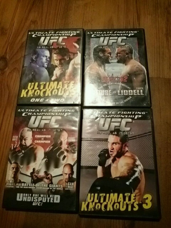 four assorted DVD movie cases 31ebc2c0-defe-4e0c-a32f-f88aaa1036be