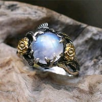 gold-colored ring with blue opal gemstone Clarksville, 37042