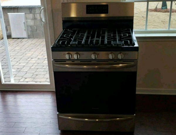 black and stainless gas range oven new