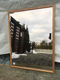 Square mirror with beige wooden frame
