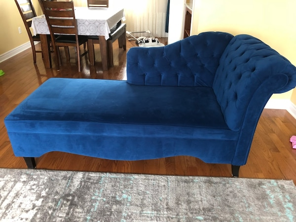 blue suede tufted sofa with throw pillows