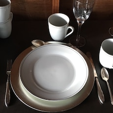 12 place setting with silver chargers mugs and wine glasses