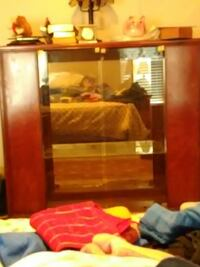 black flat screen TV; brown wooden TV stand Des Moines