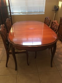 round brown wooden table with four chairs dining set Orlando, 32805