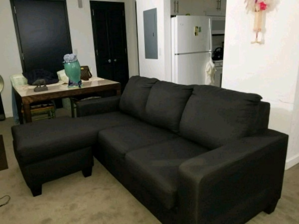 Used Black Leather Sectional Sofa With Throw Pillows For Sale In New