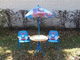 Thomas table with umbrella and chairs