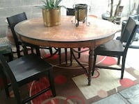 Vintage wooden table with four chairs