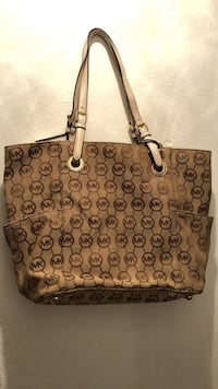 monogrammed brown Michael Kors leather tote bag