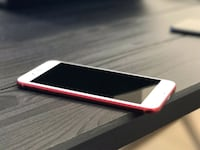 white Samsung Galaxy smartphone with red case
