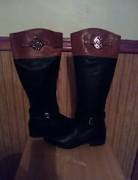 pair of black-and-brown leather knee-high boots